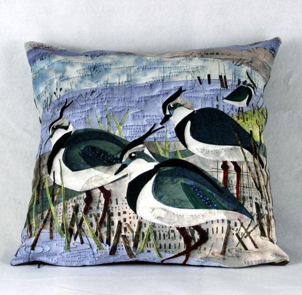 Cushion with lapwing design