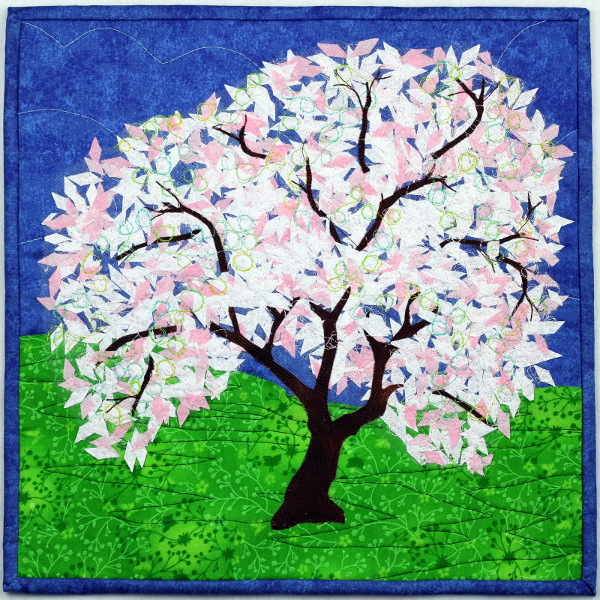A fabric picture showing a blossom tree